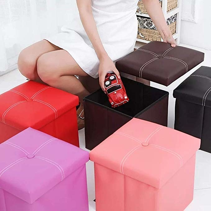Woman storing a toy car in a storage ottoman.
