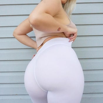 Reviewer wearing white pair and showing that no panty lines or underwear is visible