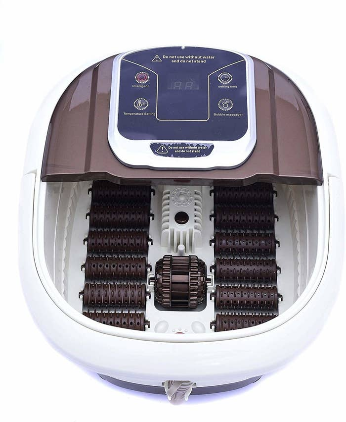 A white, blue, and brown foot massager and spa tub