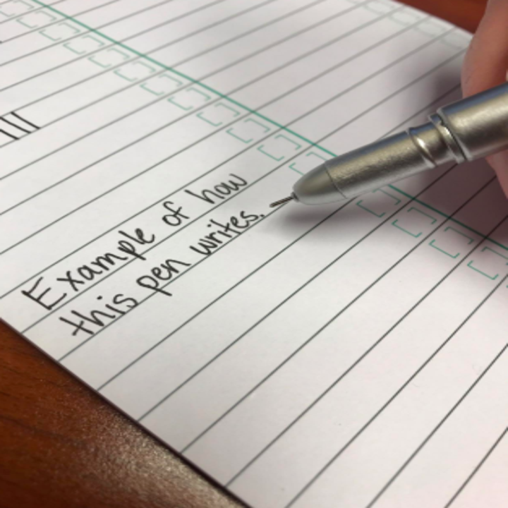 A reviewer using the very fine tip pen and demonstration how it writes