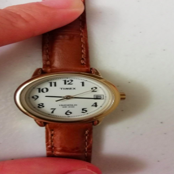 The watch with a brown strap