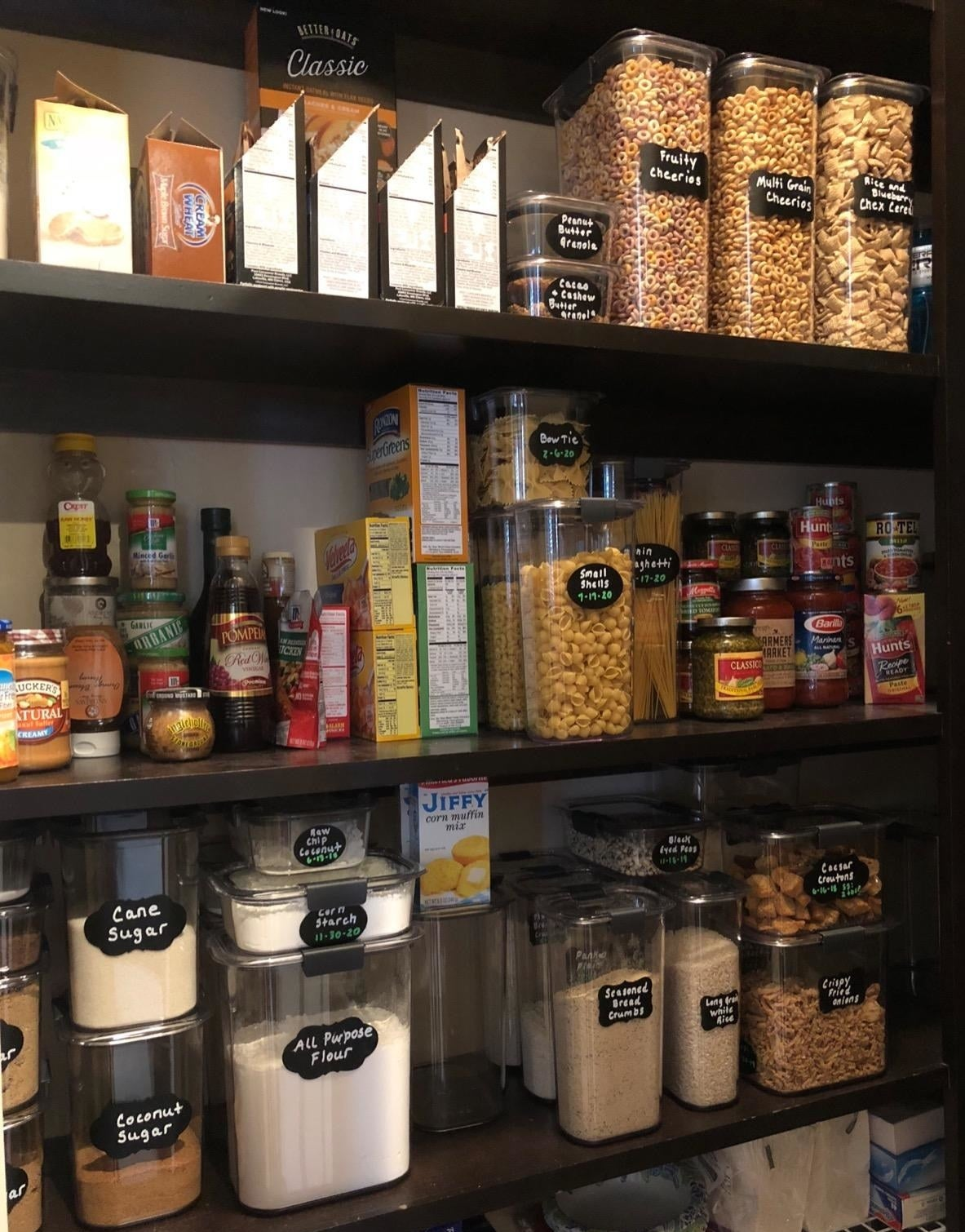 a pantry organized with about twenty labeled containers