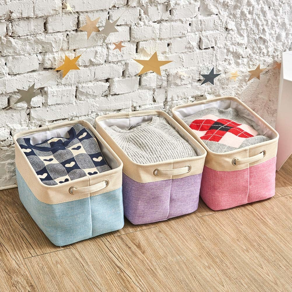 three collapsable storage bins in light blue purple and pink