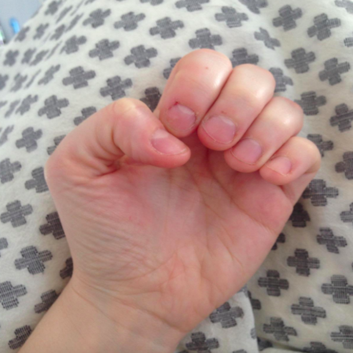 Reviewer photo showing their fingers with the varnish