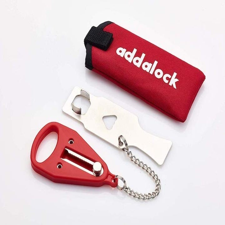 The portable door lock looks like has a rectangular shape and looks like a keychain bottle openers. It also has a chain on it.
