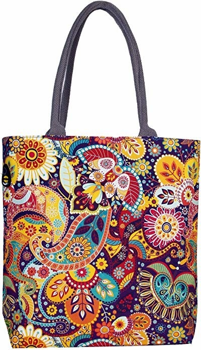 A tote bag with colourful leaf prints