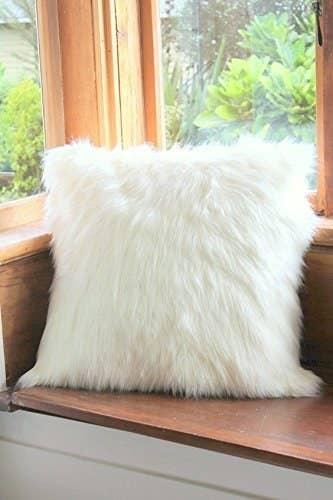White faux fur cushion.