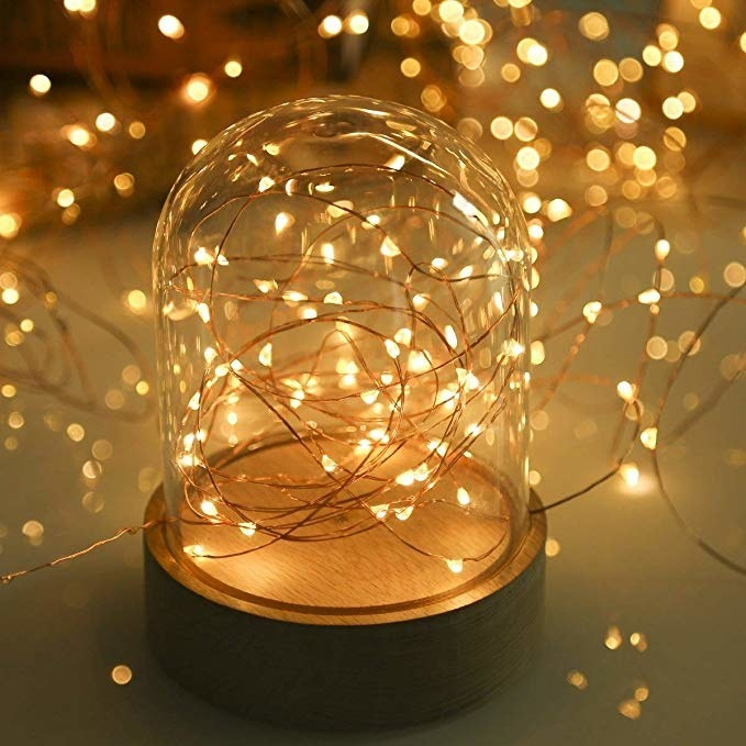 Warm yellow fairy lights in a glass jar.