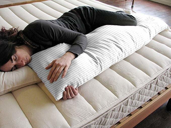 Person hugging a body pillow and sleeping.