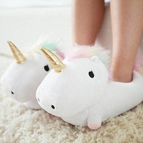 Person wearing unicorn slippers.