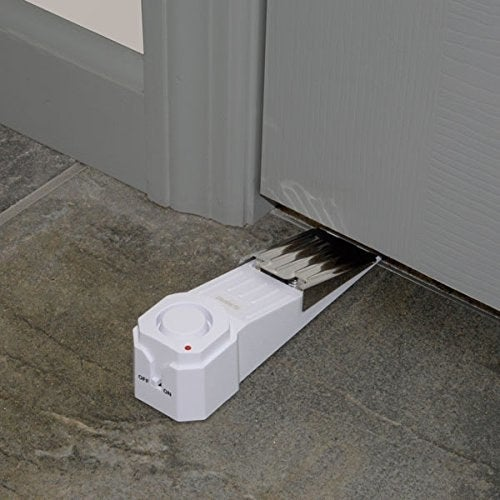 The wedge doorstop placed under a door