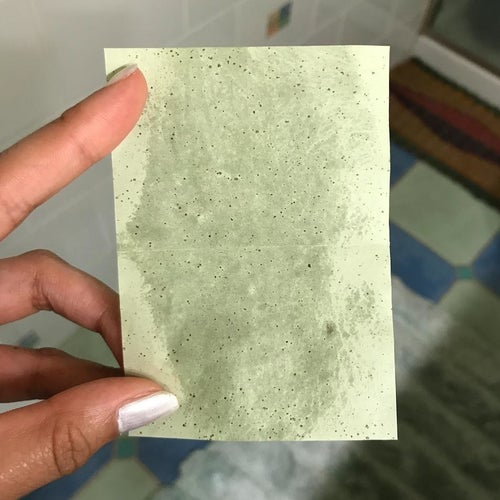 a used green sheet that's soaked in oil