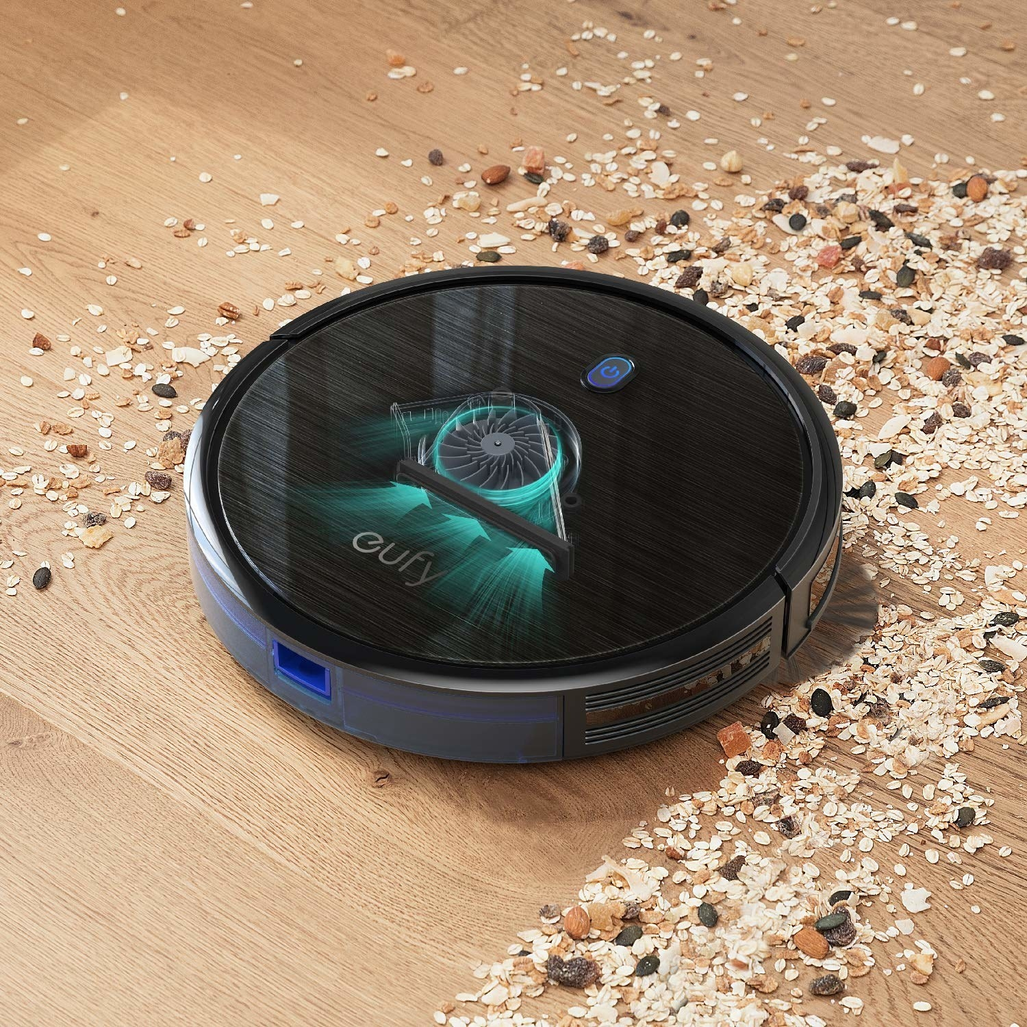 The robot vaccum picking up seeds and oats off hardwood floor