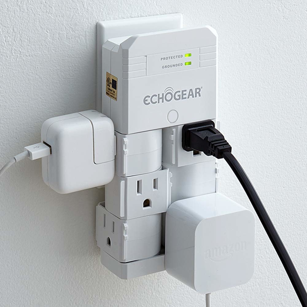 An outlet bank with three plugs plugged into it