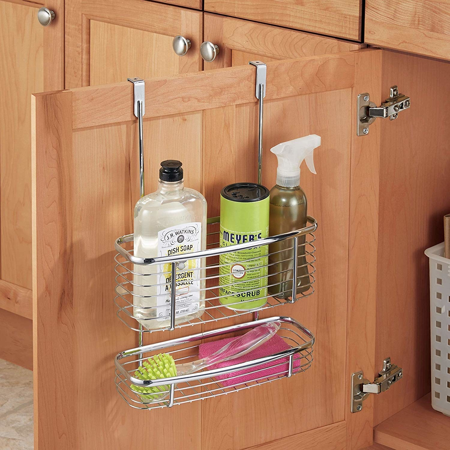 A metal organizer slipped over the top of a cabinet door