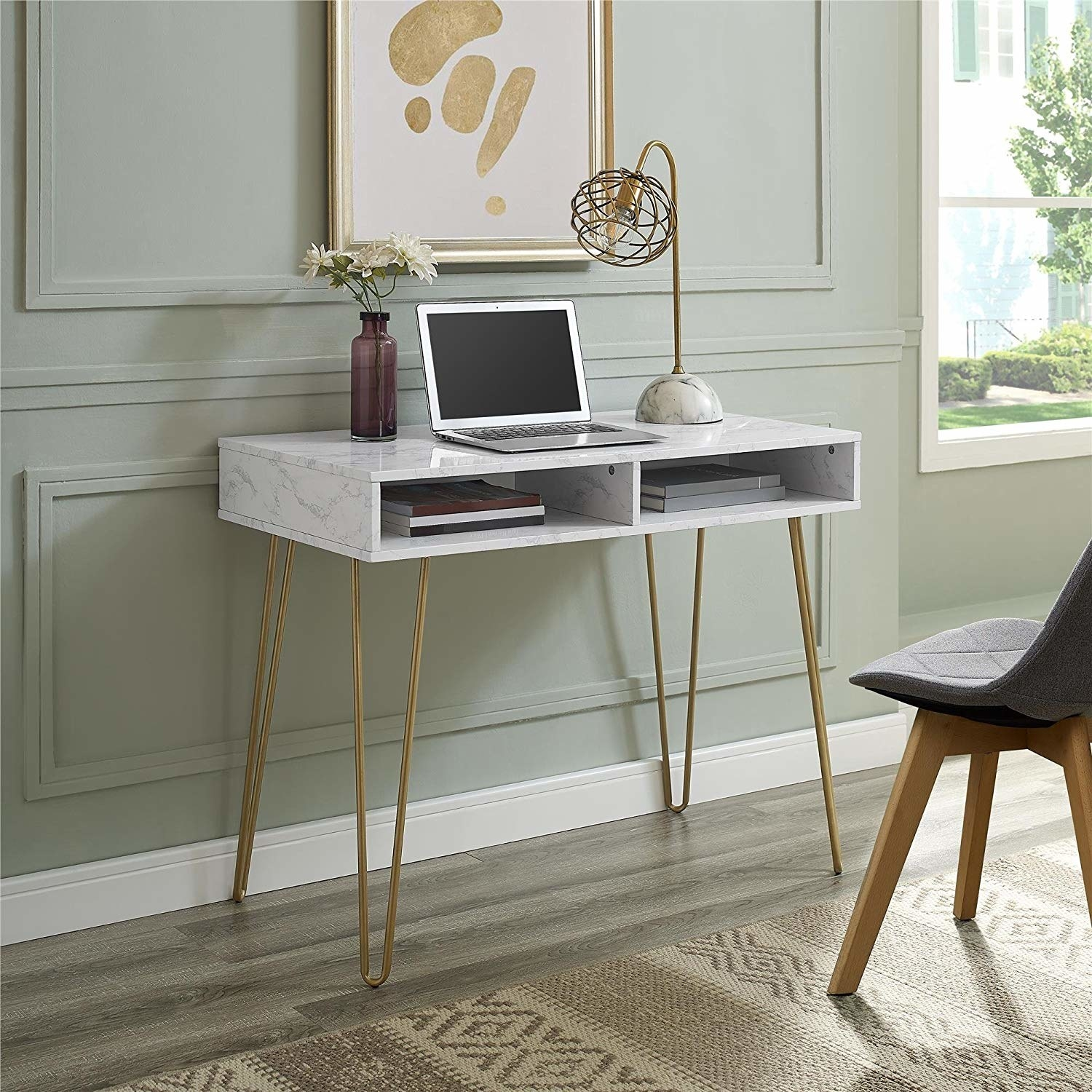 mid-century modern style white marble print desk with two open compartments with access in the front and gold tone legs