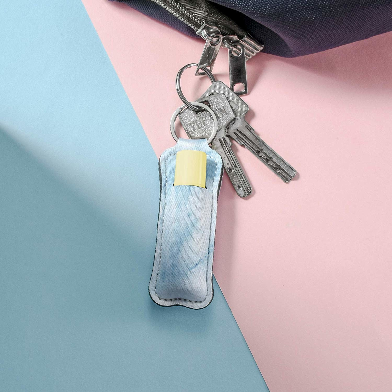 The lip balm case attached to a keyring
