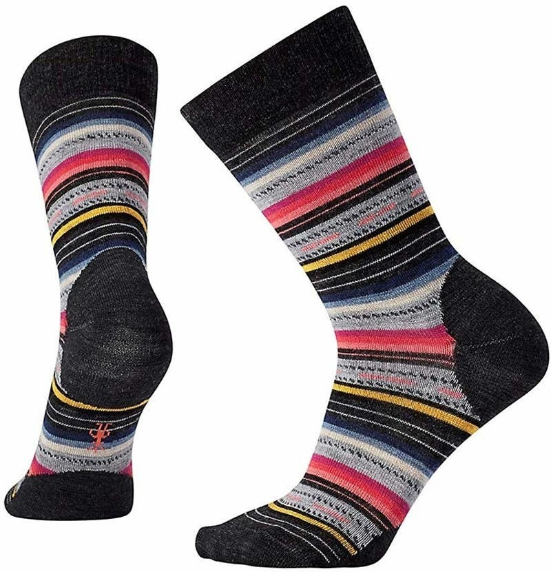 a pair of the crew-height socks in black, grey, pink, and blue stripes