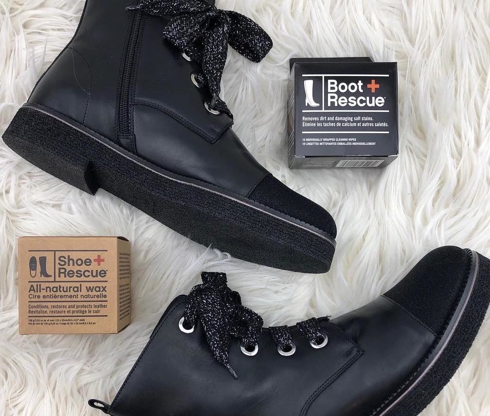 A pair of leather boots lies on a fuzzy carpet next to a box of the wipes