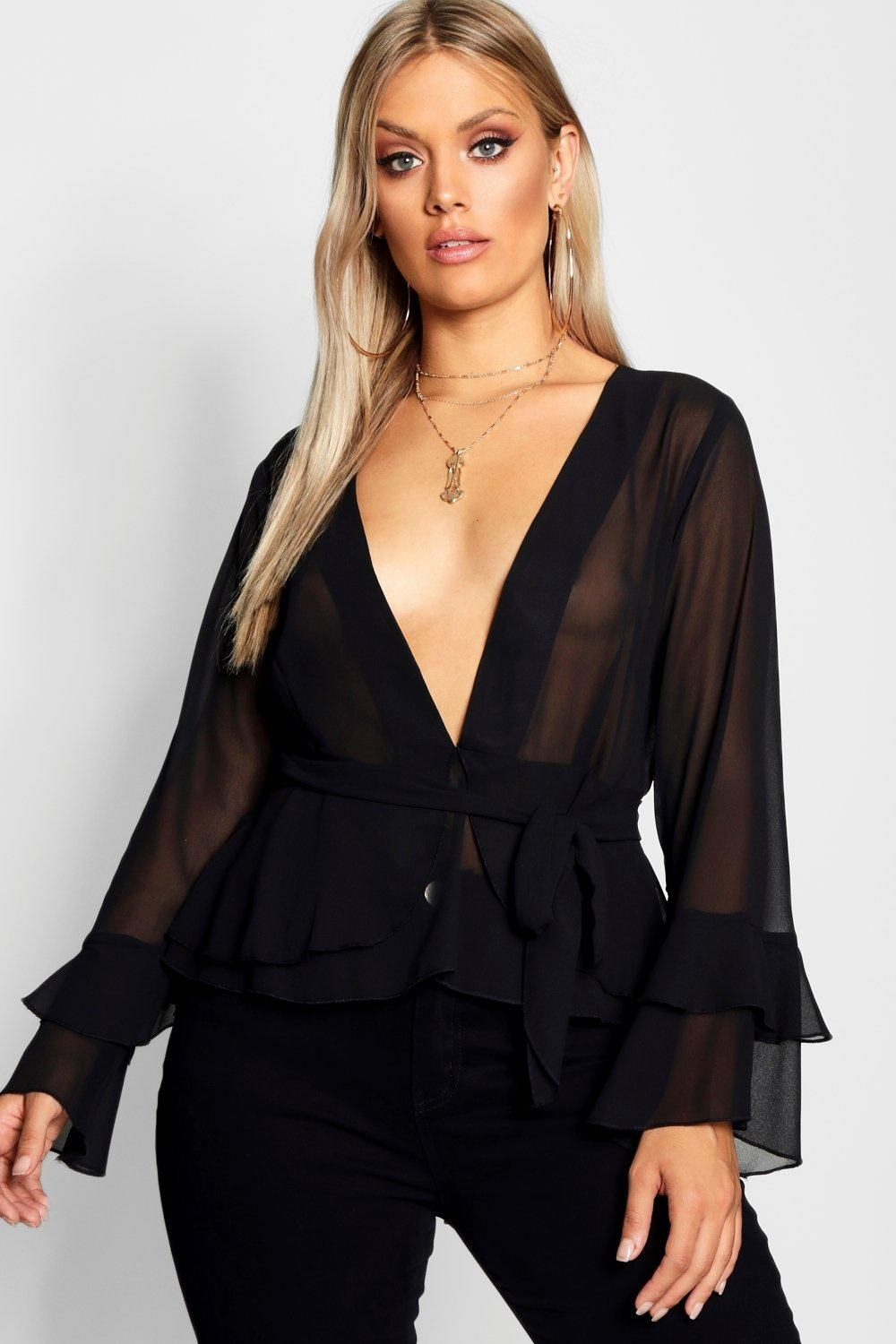 a plunging long sleeve sheer top with flare sleeves and a tie waist