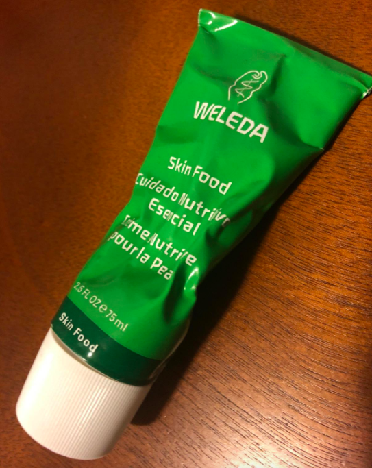 A customer review photo of a tube of Weleda Skin Food.