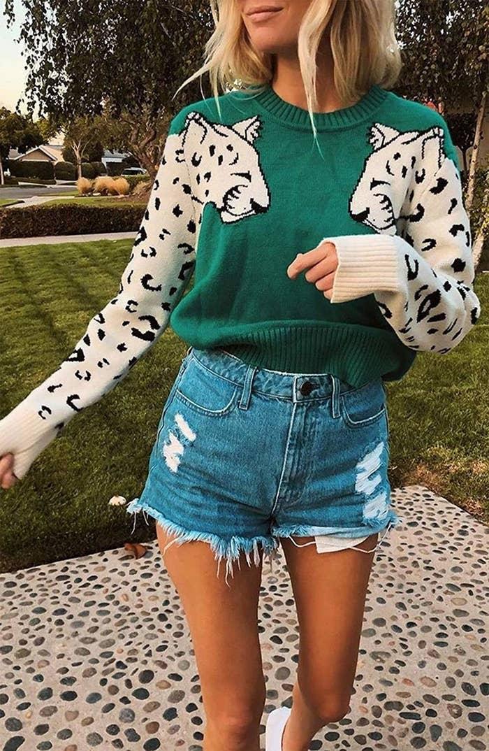 model wears leopard sweater with cut-off shorts