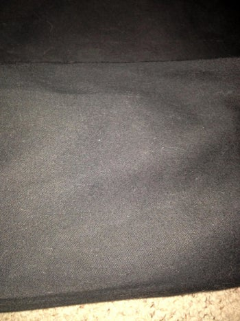 Reviewer photo of the same couch that's now free of all hair after using the vacuum