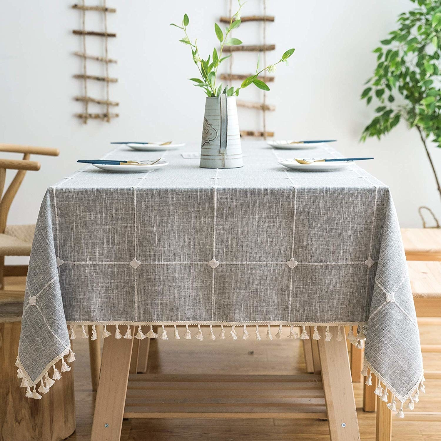 Gray tablecloth with grid pattern and tassels