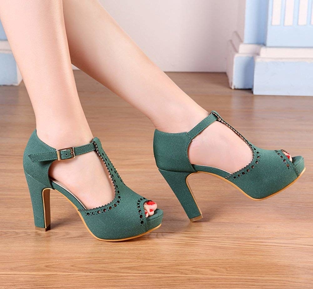 green pumps with a peep toe and a T-strap
