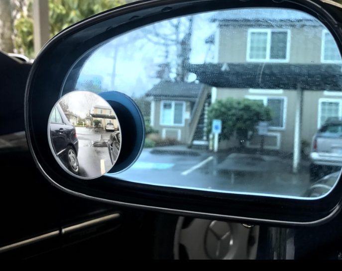 The blind spot mirror attached to a car side mirror