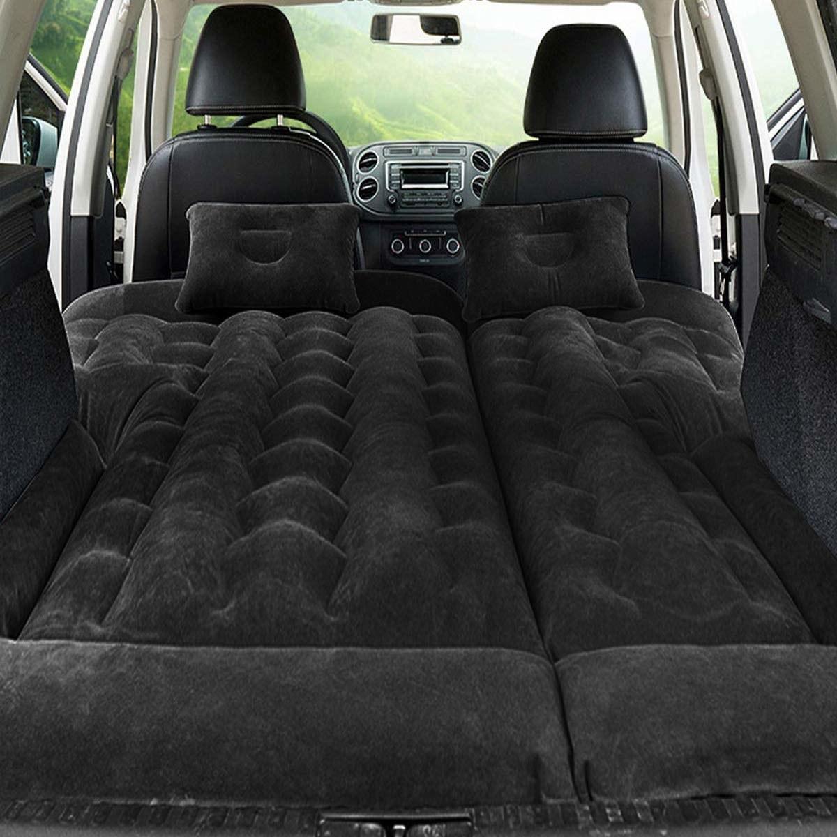 Padded air mattress inside back of car