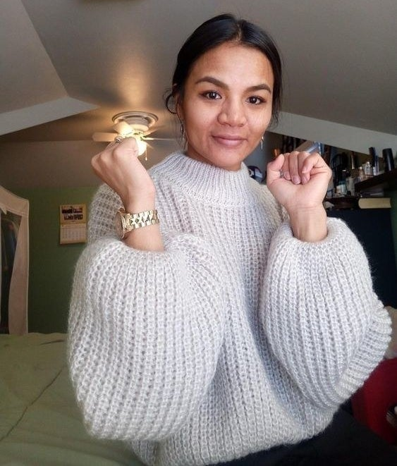 reviewer wearing balloon sleeve sweater