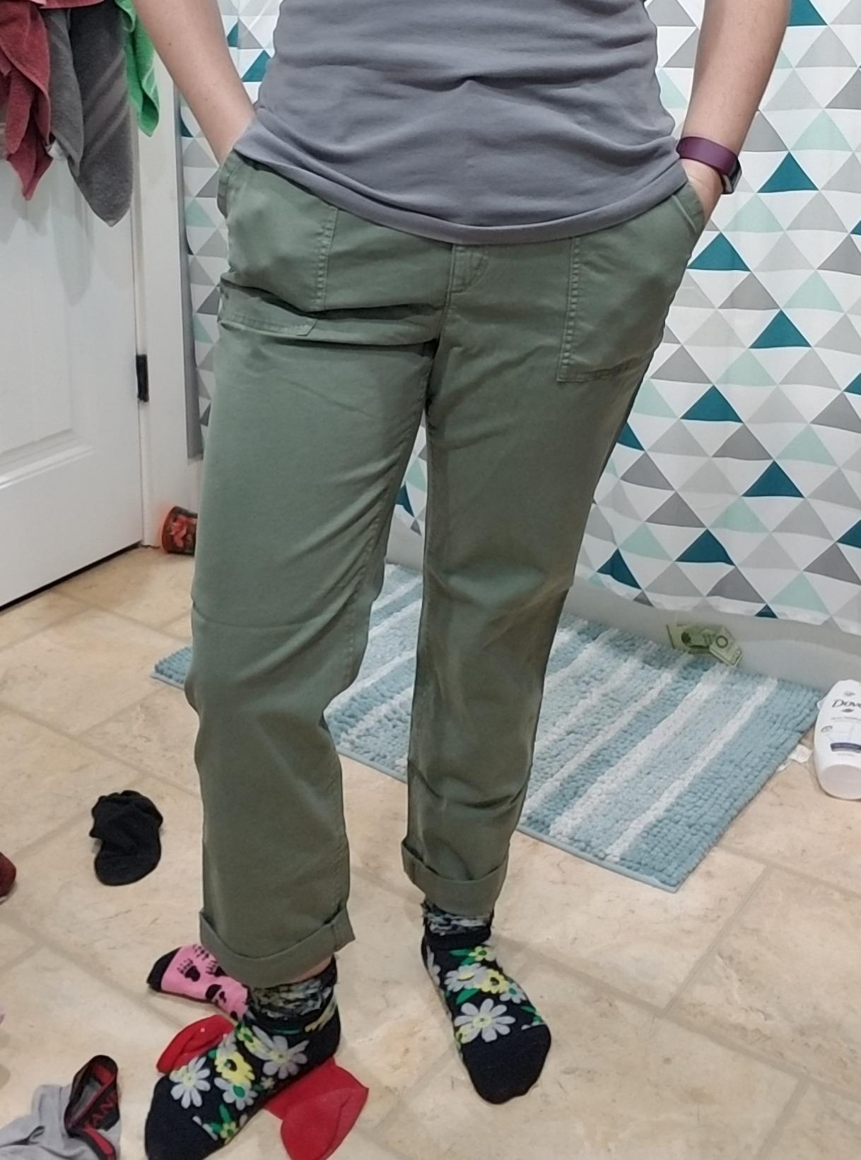 Reviewer wearing green chino pants