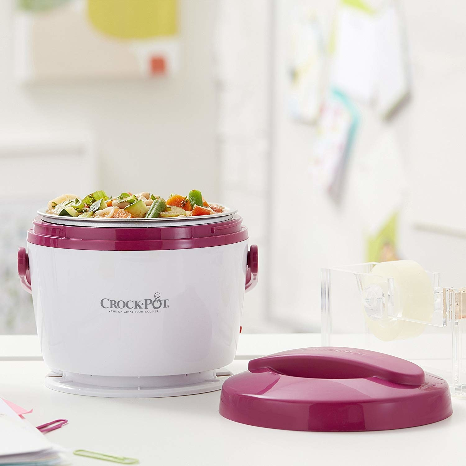 A small slow cooker with a lid on a table