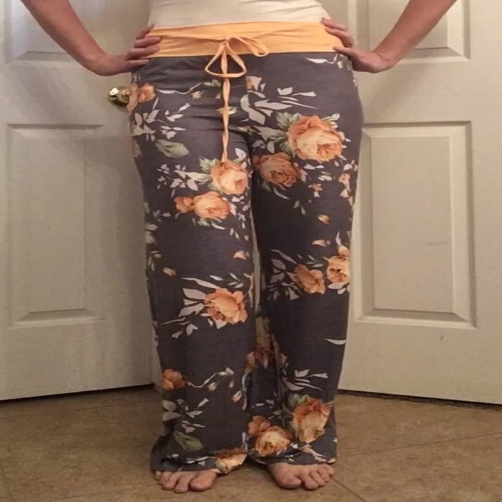 Reviewer wearing floral palazzo pants