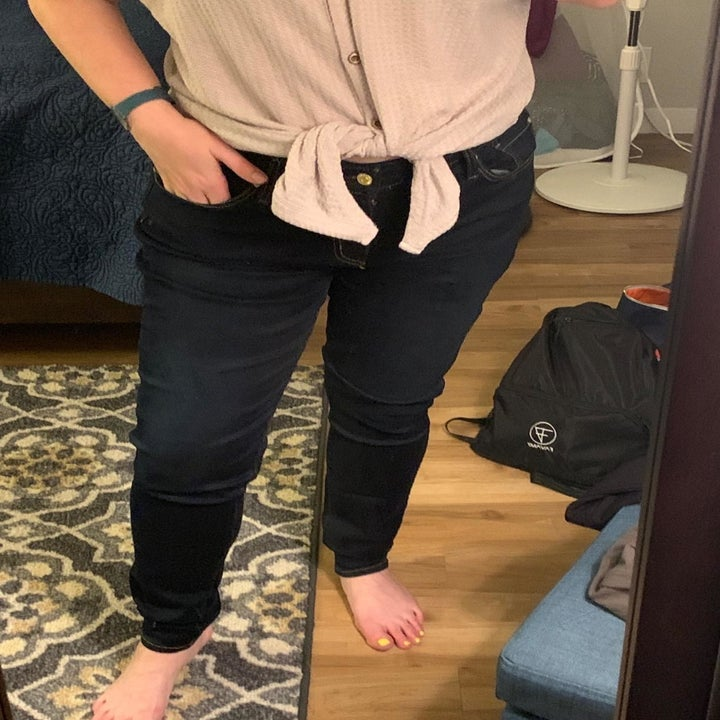 Reviewer wearing skinny jeans