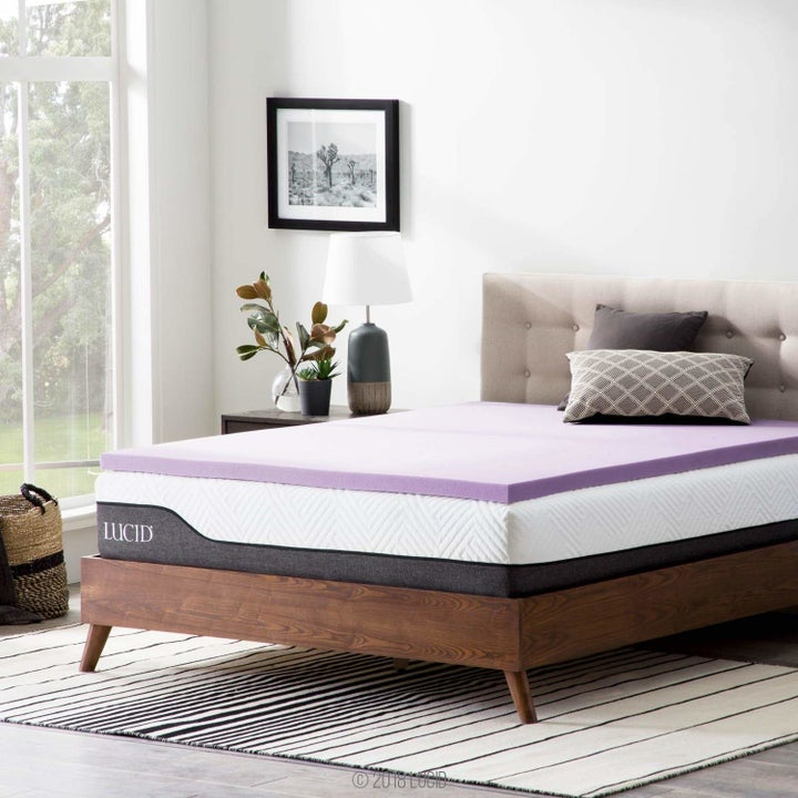 a mattress with a purple topper on it