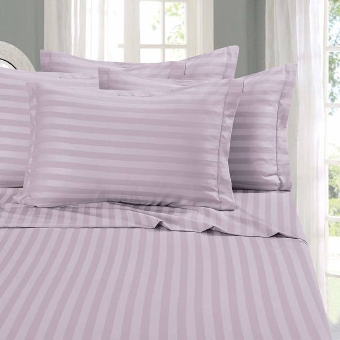Light purple striped sheets on bed