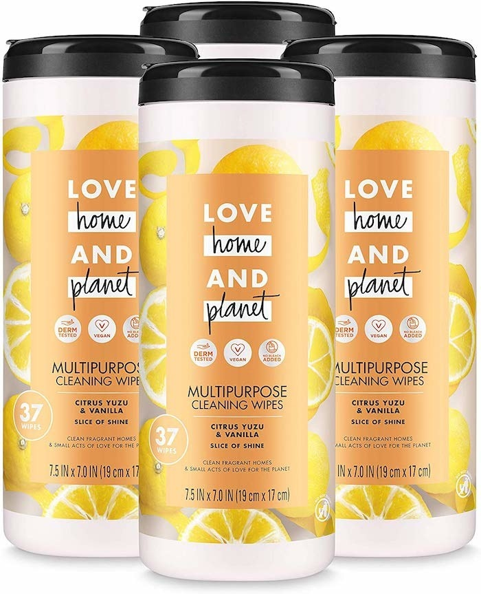 "There are three orange containers of wipes. They all have a graphic with oranges all over them to represent the flavor which is ""Citrus Yuzu & Vanilla."" They also have the brand name ""Love Home And Planet"" on them."
