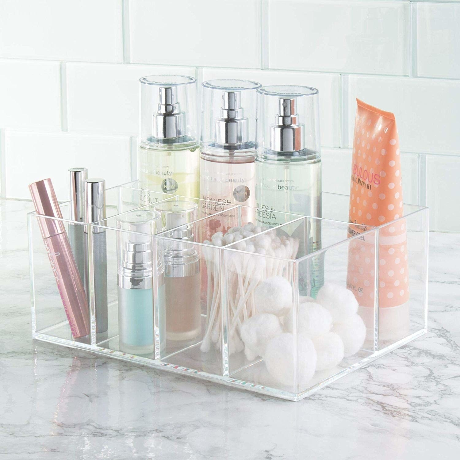 A close up of the organizer filled with neatly arranged cosmetics and beauty products