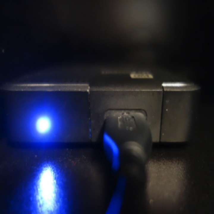 a gadget with a glowing blue light