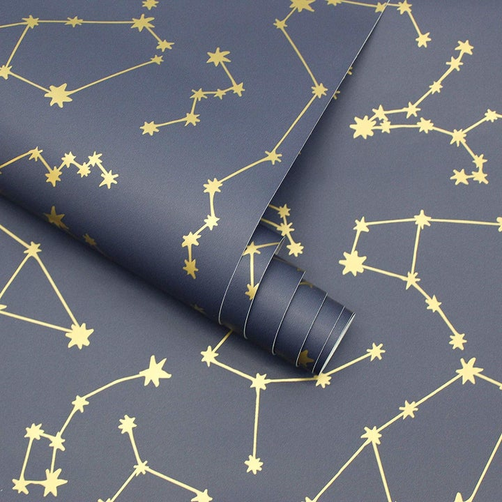 Close up: navy background with gold constellation designs