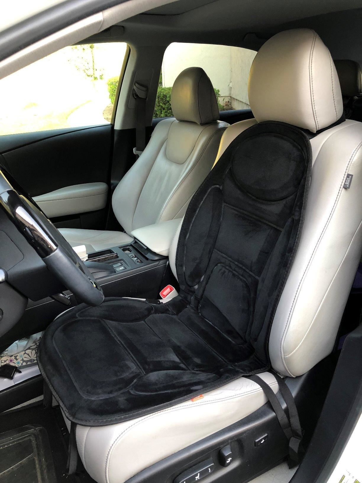 The black velvety cushion strapped to a car's driver seat