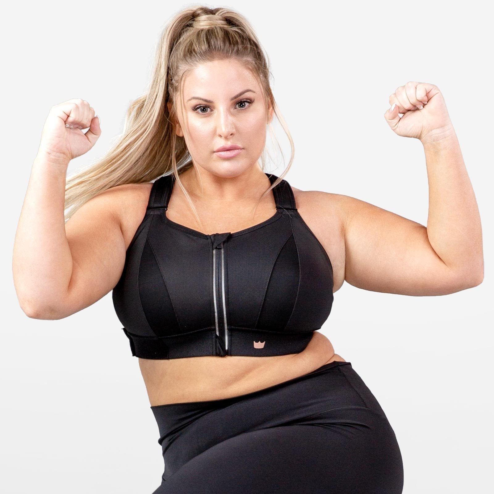 Model wears a black Shefit Ultimate Sports Bra with black leggings