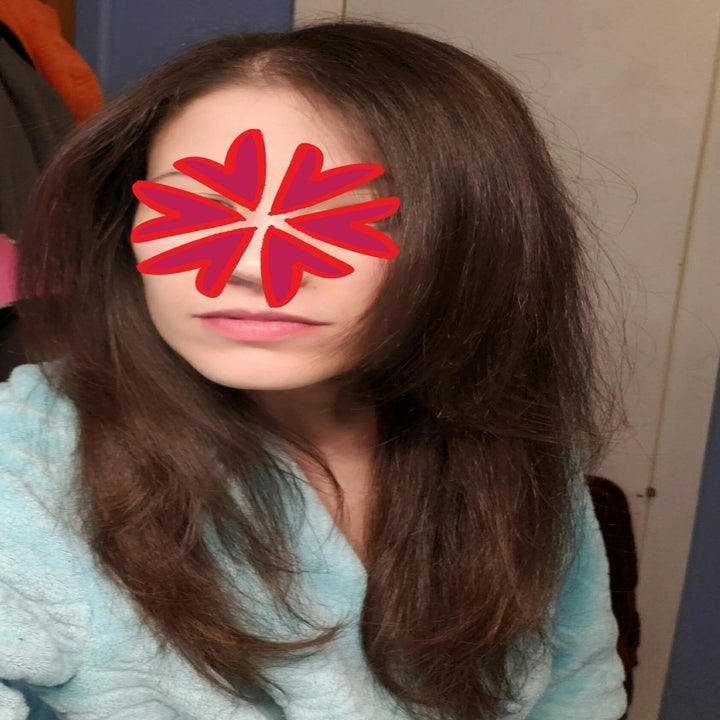 After photo of the same reviewer with sleek, shiny, straight hair