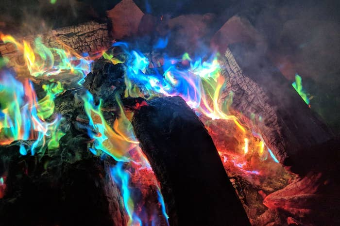 A campfire with rainbow flames
