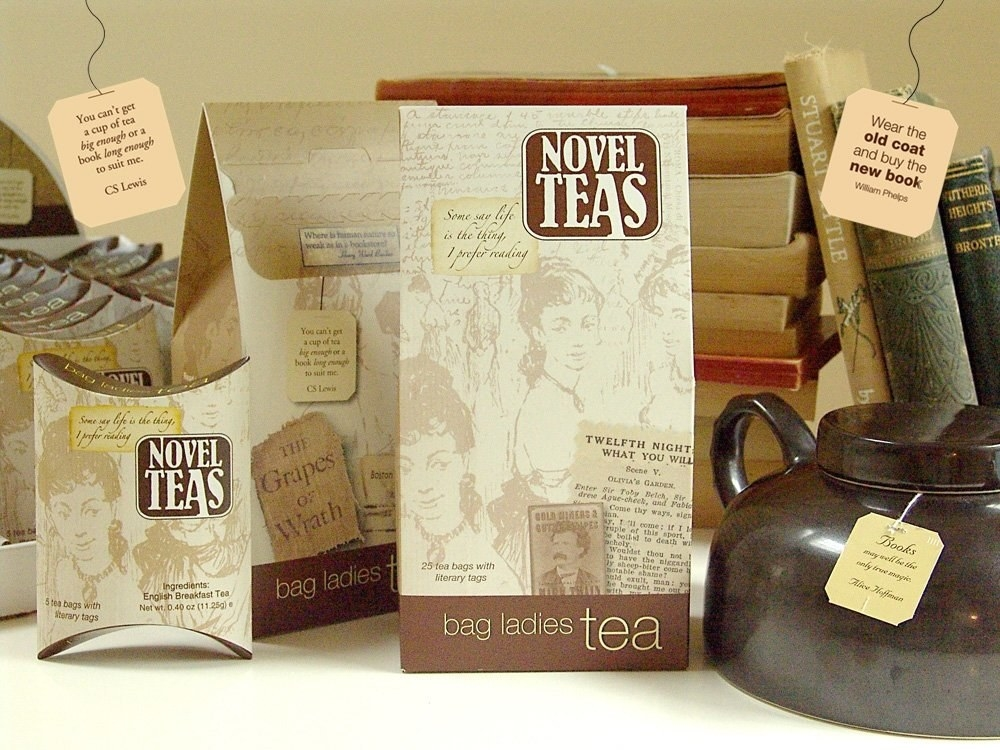 boxes of the tea in packaging that has old timey looking books, characters, and passages printed on them