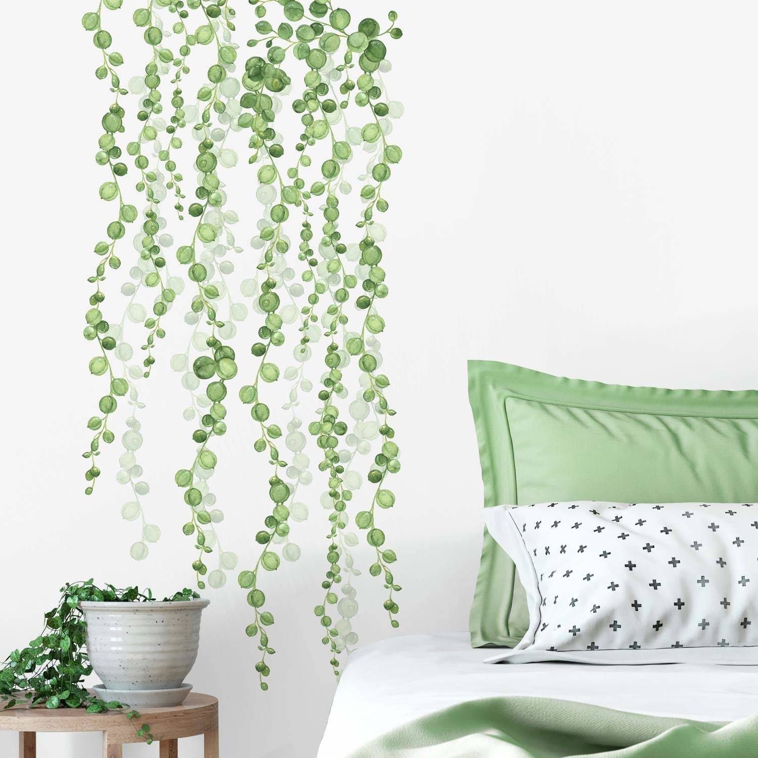 green wall decal mimicking vines descending down a wall