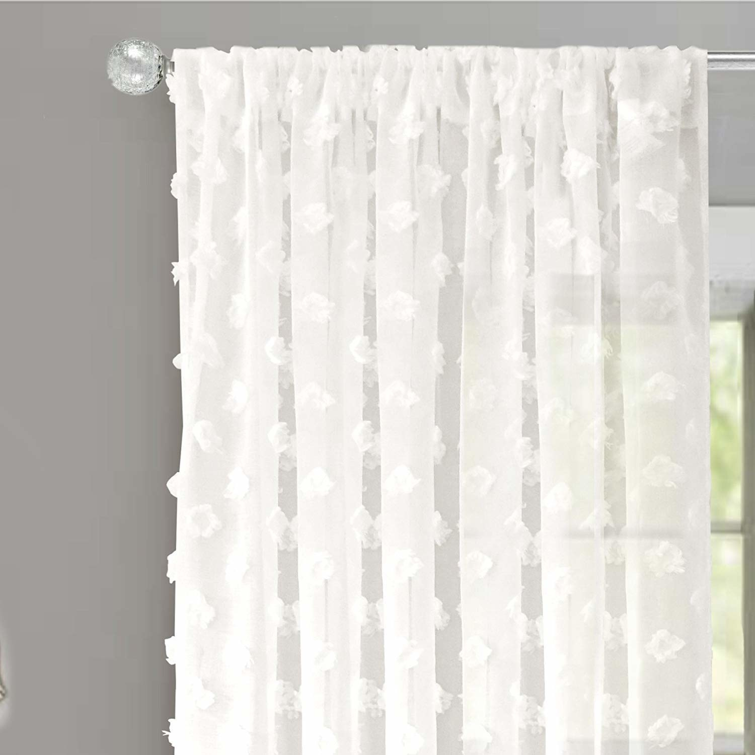 Sheer white curtains in front of a window