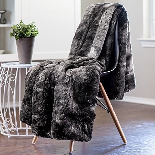 gray faux fur blanket slung over a chair